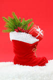 Red christmas boot. On red background royalty free stock photography