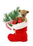 Red christmas boot. With gift boxes and teddy bear isolated on white background stock photo