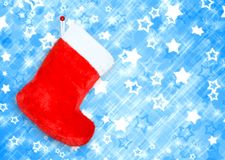 Red christmas boot  on blue background Stock Photo