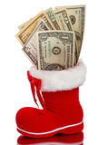 Red Christmas boot with dollars Stock Images