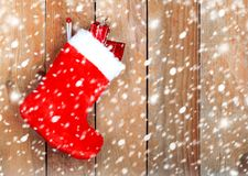 Red christmas boot with gifts Stock Images