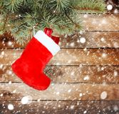 Red christmas boot with gifts Royalty Free Stock Photos