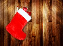 Red christmas boot with gifts on background Stock Image