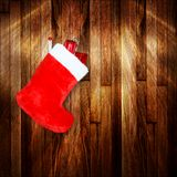 Red christmas boot with gifts on background Royalty Free Stock Photography