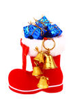 Red Christmas boot with gifts and bells Royalty Free Stock Photos