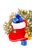 Red Christmas boot with gifts and bells Royalty Free Stock Photo