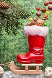 Red christmas boot with nuts on a sled. With copy space.  Christmas background Royalty Free Stock Photo