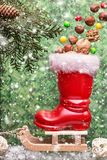 Red christmas boot with nuts on a sled. With copyspace.  Christmas background Stock Photography