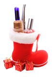 Red Christmas boots with cosmetics as a gift Royalty Free Stock Photo