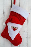 Red Christmas boots with textile head of Santa Claus Royalty Free Stock Photos