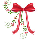 Red christmas bow. Red satin christmas bow with lingon berries and green leaves Stock Image