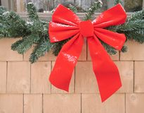 Red Christmas bow. Decorating the outside of a house Royalty Free Stock Image