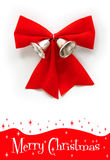 Red christmas bow with bell. Isolated red christmas ribow with two silver bell Royalty Free Stock Photos