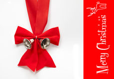 Red christmas bow with bell. Isolated red christmas ribow with two silver bell Stock Photography