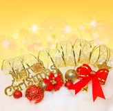 Red Christmas bow,Christmas balls with golden ribbon Royalty Free Stock Image
