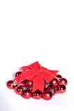 Red Christmas bow and small balls Royalty Free Stock Photos