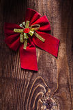 Red christmas bow on very old wooden background Royalty Free Stock Photo