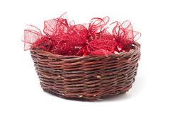Red christmas bows in wicker basket Royalty Free Stock Images