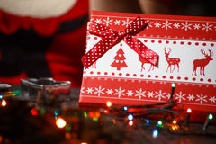 Red Christmas box with deer and garland. ! Royalty Free Stock Photography
