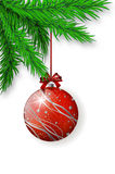 Red Christmas bulb hanging on spruce twig Royalty Free Stock Images