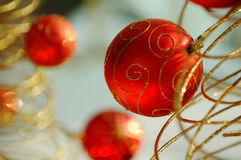 Red christmas bulbs. Some christmas balls decorated on a golden frame made tree Stock Photo