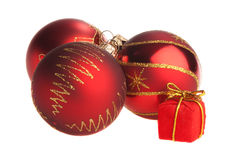 Red Christmas bulbs with tiny present box Stock Images