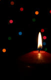 Red Christmas Candle. A single lit red Christmas candle Royalty Free Stock Photos
