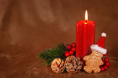 Red christmas candle. On brown background Royalty Free Stock Photography