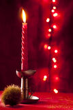 Red Christmas Candle. With Chestnut Bur Stock Images