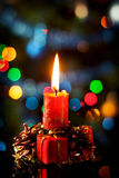 Red christmas candle in atmospheric light Stock Photos