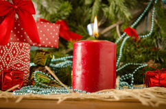 Red christmas candle balls fir branches flame. On a colored background Stock Photography