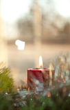 Red Christmas candle burning Stock Photos