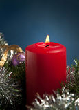Red Christmas candle burning Stock Photography