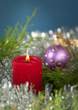 Red Christmas candle burning Royalty Free Stock Images
