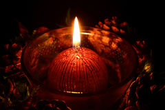 Red christmas candle burning on a black background Royalty Free Stock Image