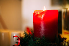Red christmas candle burning, lit, switched on. Christmas decora. Tion decorative ornament Stock Photos