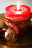 Red Christmas candle and Christmas ornaments. On white background Royalty Free Stock Photo
