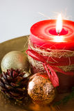 Red Christmas candle and Christmas ornaments. On white background Royalty Free Stock Photos