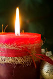 Red Christmas candle and Christmas ornaments. On wood Royalty Free Stock Images