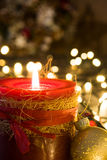 Red Christmas candle and Christmas ornaments. On wooden background Royalty Free Stock Photos
