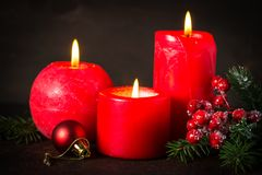 Red christmas candle. On dark background Stock Image