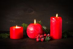 Red christmas candle. On dark background Royalty Free Stock Images