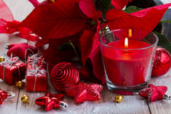 Red christmas candle with decorations. Red  christmas candle  with balls and stars Stock Images