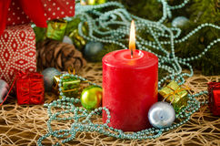 Red christmas candle flame balls. On a colored background Stock Photography