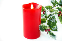 Red Christmas Candle and Holly Branch Royalty Free Stock Images