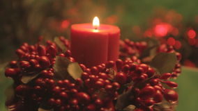 Red Christmas candle with holly stock footage