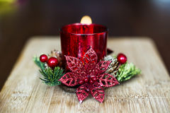Red christmas candle for home decoration. On a bokeh background stock photo
