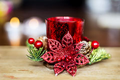 Red christmas candle for home decoration. On a bokeh background royalty free stock photography