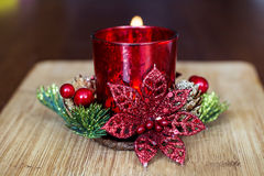 Red christmas candle for home decoration. On a bokeh background royalty free stock photos