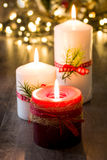 Red Christmas candle. And Christmas light Royalty Free Stock Photo